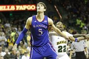 Kansas' Jeff Withey (5) and Baylor's A.J. Walton (22) position for a rebound in KU's 81-58 loss to the Baylor Bears Saturday in Waco, Texas.