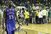 Elijah Johnson (15) leaves the court as Baylor fans surround Baylor players at half court after KU's 81-58 loss to the Baylor Bears Saturday in Waco.