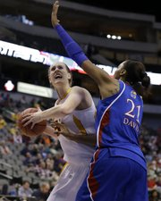 Iowa State' Anna Prins looks for a shot against Kansas' Carolyn Davis (21) in the first half on Saturday in the Big 12 women's tournament in Dallas. ISU won, 77-62.