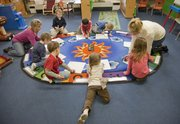 Preschoolers at First Presbyterian Church, 2145 Clinton Parkway, work on drawing the letter V in a class exercise.