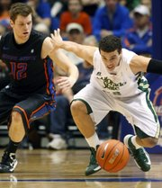 Colorado State guard Dorian Green chases a loose ball with Boise State guard Igor Hadziomerovic (12) during an NCAA college basketball game in Boise, Idaho, Saturday, March 2, 2013.