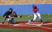 Kansas first baseman Alex DeLeon comes around on a pitch for a double during the fifth inning against Jackson State at Hoglund Ballpark, Wednesday, March 13, 2013.