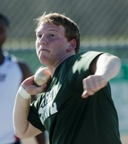 Free State sophomore Josiah LeBrun releases the shot put during the Firebirds' season-opening track and field quadrangular, Thursday, March 14, 2013, at FSHS.