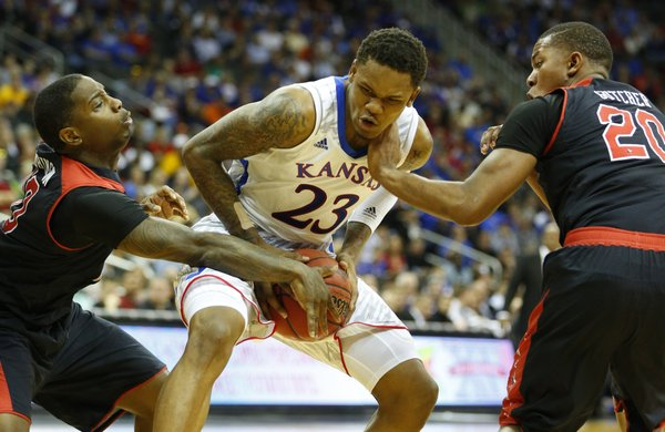 Kansas guard Ben McLemore looks to maintain possession against Texas Tech players Daylen Robinson, left, and Toddrick Gotcher during the second half of the second round of the Big 12 tournament on Thursday, March 14, 2013 at the Sprint Center in Kansas City, Missouri.