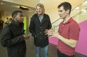 The Rev. Justin Jenkins, right, pastor of Velocity Church, visits with Derock Swaggert, left, and Brysson Rockwell, both of Tampa, Fla., following a Velocity Church service March 10 at Lawrence Arts Center, 940 New Hampshire St.