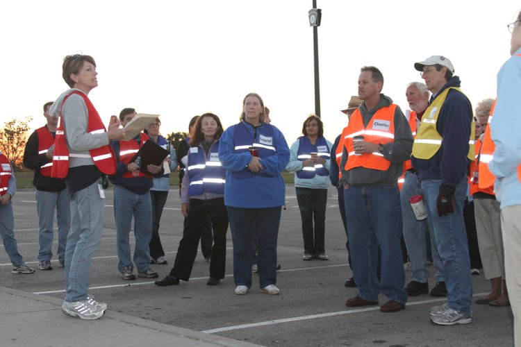 Director of Clinic Services Kim Ens, left, gives instructions to staff and volunteers before a community drive-through flu shot clinic Oct. 16, 2010.