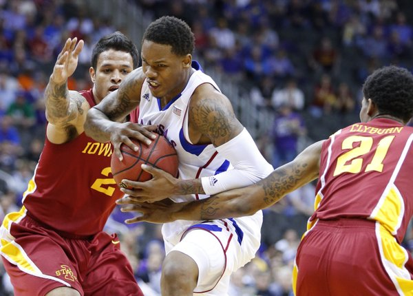 Kansas guard Ben McLemore drives between Iowa State defenders Chris Babb, left, and Willy Clyburn during the first half of the semifinal round of the Big 12 tournament on Friday, March 15, 2013 at the Sprint Center in Kansas City, Missouri.
