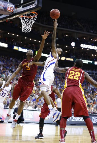 Kansas guard Naadir Tharpe heads to the bucket between Iowa State players Melvin Ejim (3) and Anthony Booker (22) during the second half of the semifinal round of the Big 12 tournament on Friday, March 15, 2013 at the Sprint Center in Kansas City, Missouri.