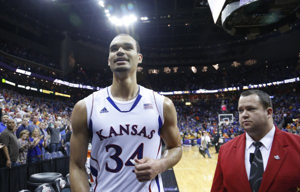 Kansas forward Perry Ellis flashes a rare smile as he is applauded by the Kansas fans after leaving the court following the Jayhawks' 88-73 win over Iowa State in the semifinal round of the Big 12 tournament on Friday, March 15, 2013 at the Sprint Center in Kansas City, Missouri.
