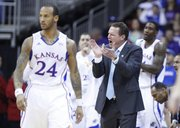 Kansas head coach Bill Self applauds the Jayhawks after forcing a shot clock violation against Kansas State during the first half of the Big 12 tournament championship on Saturday, March 16 2013 at the Sprint Center in Kansas City, Mo.