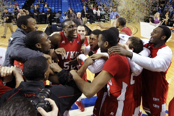 Western Kentucky's T.J. Price (52) celebrates with teammates after the Sun Belt Conference championship game against Florida International on Monday, March 11, 2013, in Hot Springs, Ark., Monday, March 11, 2013. Western Kentucky won 65-63. Price was named the tournament's most valuable player. WKU will face Kansas University in the first round of the NCAA Tournament on Friday, March 22, 2013, in Kansas City, Mo.