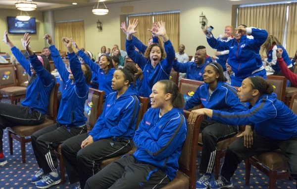 Members of the Kansas women&#39;s basketball team celebrate as they learn their fate in the 2013 NCAA Women&#39;s Tournament Monday evening at Allen Fieldhouse. The Jayhawks earned the 12th seed in the Norfolk region and will play fifth seeded Colorado at 5:30 p.m. on Saturday.