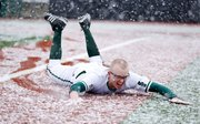 Free State senior Lee McMahon slides across the third baseline after a running start following the cancellation of the Firebirds' home game against Warrensburg on Tuesday, March 19, 2013. McMahon later said he wasn't happy the game was cancelled, however. Nick Krug/Journal-World Photo