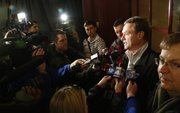 Kansas basketball coach Bill Self talks with media members after the Jayhawks' arrival at the Westin Crown Center on Wednesday, March 20, 2013 in Kansas City, Mo.