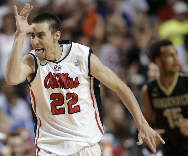 Mississippi guard Marshall Henderson (22) gestures after he made a 3-point shot against Vanderbilt during the second half of an NCAA college basketball game in the semifinals of the Southeastern Conference tournament, Saturday, March 16, 2013, in Nashville, Tenn.