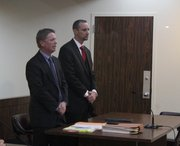 Franklin County Sheriff Jeff Curry, right, appears with his attorney, Trey Pettlon, at a hearing to remove Curry from office in March. Prosecutors withdrew their petition to remove Curry after Pettlon announced that Curry had agreed to resign, effective April 1.