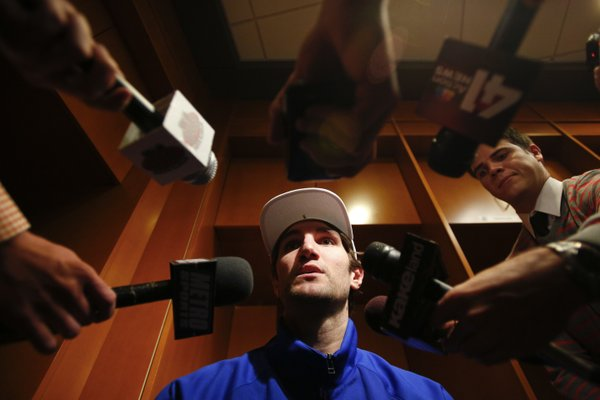 Kansas center Jeff Withey takes questions in the locker room on Thursday, March 22, 2013 at the Sprint Center in Kansas City, Mo.