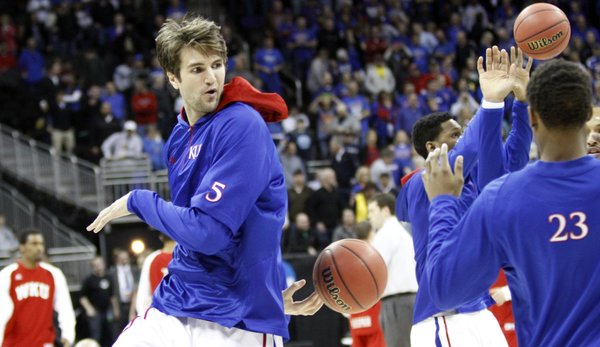 Jeff Withey tosses a behind his back pass during warm-ups with the Jayhawks before their second-round game against Western Kentucky Friday, March 22, 2013 at the Sprint Center in Kansas City, Mo.