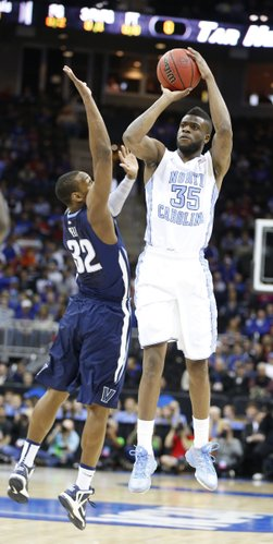 North Carolina guard Reggie Bullock pulls up for a three over Villanova guard James Bell during the first half on Friday, March 22, 2013 at the Sprint Center in Kansas City, Mo.