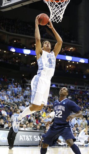 North Carolina forward James Michael McAdoo heads to the bucket over Villanova forward JayVaughn Pinkston during the first half on Friday, March 22, 2013 at the Sprint Center in Kansas City, Mo.