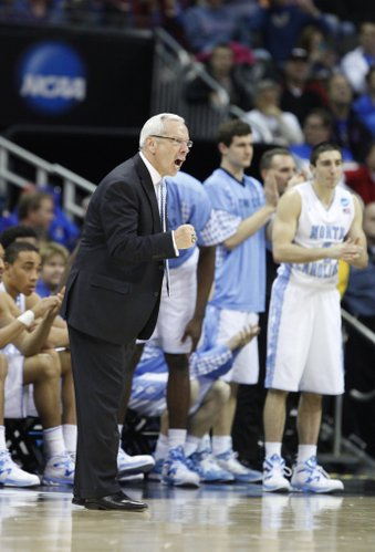 North Carolina head coach Roy Williams pumps his fist as the Tarheels close out the game against Villanova during the second half on Friday, March 22, 2013 at the Sprint Center in Kansas City, Mo.