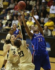 Kansas forward Carolyn Davis (21) shoots over Colorado guard Chucky Jeffery (23) and forward Arielle Roberson (32) in the first half of a first-round women's NCAA Tournament game on Saturday, March 23, 2013, in Boulder, Colo.