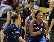 Kansas' Monica Engelman (13) and Bunny Williams (5) celebrate with teammates after they defeated Colorado 67-52 in a first-round women's NCAA college basketball game on Saturday, March 23, 2013, in Boulder, Colo.