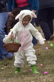 Saturday's cool temperatures didn't stop more than 350 children from taking the field at Hobbs Park to hunt for Easter eggs. The egg hunt was hosted by The Greenhouse Culture, and businesses donated more than 4,000 prizes for the event. Dressed in a bunny outfit, Jenna Joseph, 2, joins in on the fun.
