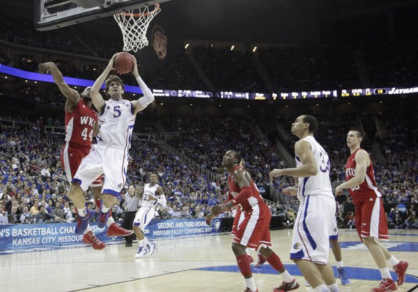 Jeff Withey (5) drives to the basket in the second-half of the Jayhawks 64-57 second-round win against Western Kentucky Friday, March 22, 2013 at the Sprint Center in Kansas City, Mo.