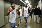 North Carolina guard Dexter Strickland hams it up for the cameras outside the team locker room, Saturday, March 23, 2013 at the Sprint Center in Kansas City, Mo.