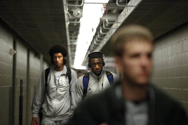 Kansas players Elijah Johnson, right, and Kevin Young make their way to the team locker room before practice, Saturday, March 23, 2013 at the Sprint Center in Kansas City, Mo.