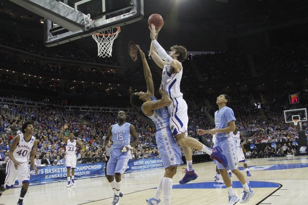 Kansas center Jeff Withey puts up a shot over North Carolina forward James Michael McAdoo in the first half on Sunday, March 24, 2013 at the Sprint Center in Kansas City, Mo..