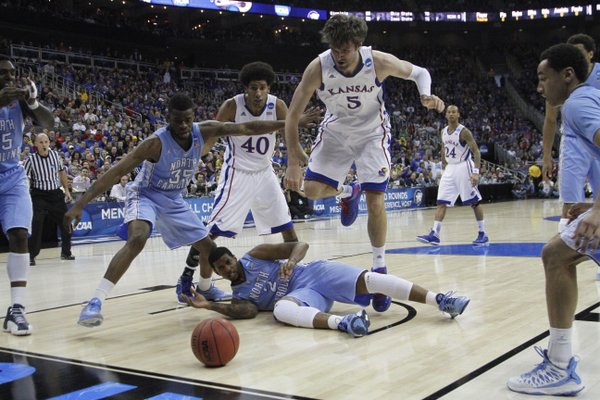 Kansas center Jeff Withey (5) jumps over North Carolina guard Leslie McDonald after a loose ball in the first half on Sunday, March 24, 2013 at the Sprint Center in Kansas City, Mo.