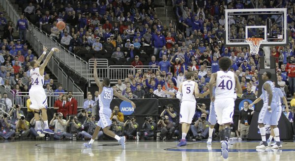 Kansas guard Travis Releford (24) shoots in a second-half three that help propel the Jayhawks to a 70-58 win against North Carolina Sunday, March 24, 2013 at the Sprint Center in Kansas City, Mo..