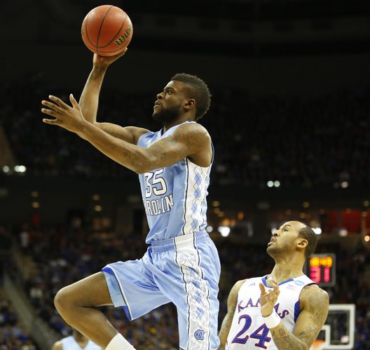 Kansas guard Travis Releford watches as North Carolina guard Reggie Bullock heads to the bucket during the first half, Sunday, March 24, 2013 at the Sprint Center in Kansas City, Mo.