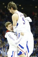 Kansas center Jeff Withey is hoisted up by teammate Tyler Self during a timeout in the second half, Sunday, March 24, 2013 at the Sprint Center in Kansas City, Mo.