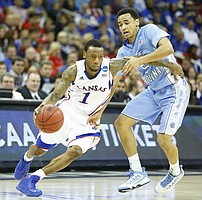 Kansas guard Naadir Tharpe is defended by North Carolina guard Marcus Paige during the second half, Sunday, March 24, 2013 at the Sprint Center in Kansas City, Mo.