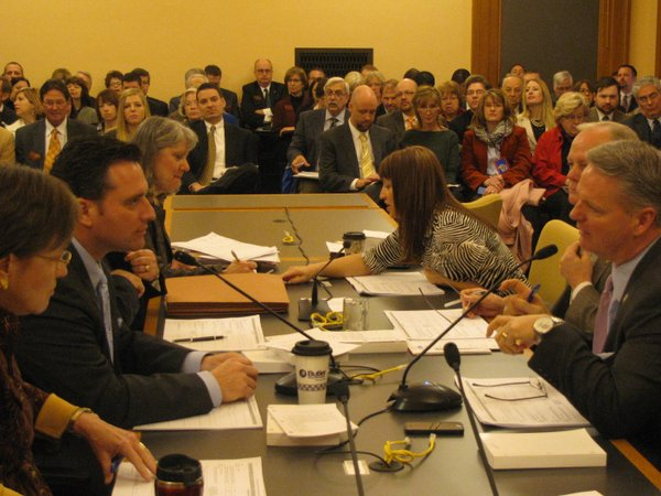 State Sen. Ty Masterson, R-Andover, (left) who is chair of the Senate Ways and Means Committee, and state Rep. Marc Rhoades, R-Newton, chair of the House Appropriations Committee, start conference committee negotiations on the state budget.