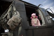 Richard Gwin/Journal World Photo. Malia Suttton, age 3, looks out the window of a Blackhawk Helicopter as she and preschoolers at the First United Methodist Church, 867 Highway 40, were treated to a surprise visit from the U.S. Army.