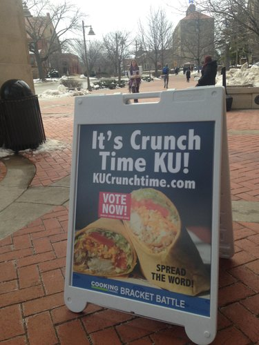A sign in front of the Kansas Union.