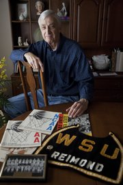 Jerry Reimond sits in his Lawrence home with memorabilia from his days at Wichita State, where he was a reserve on the 1965 WSU team that made the school's lone Final Four appearance.