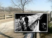 Here's how the bridge near where a triple murder was discovered 40 years ago looks today. The back and white photo shows Franklin County Sheriff's Office Dep. Brad Gilges and Sheriff Rex Bowling standing near the spot at the 25th anniversary of the crime in 1998. The bridge covers Rock Creek, about a mile south of Ottawa.