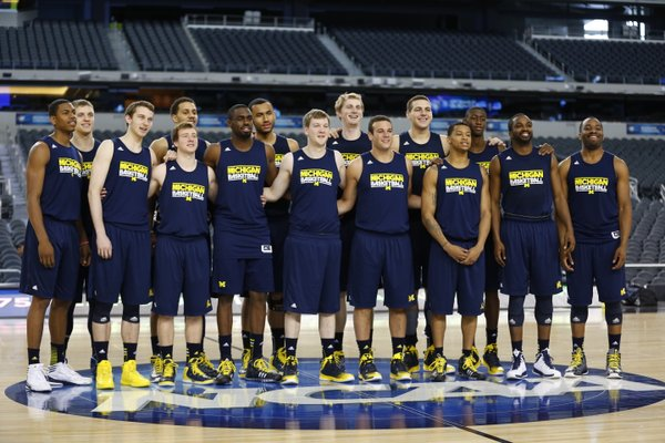 The Michigan players pose for a team photograph during a day of practices and press conference for teams in the South Regional at Cowboys Stadium in Arlington, Texas on Thursday, March 28, 2013.