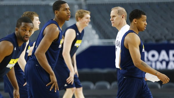 Michigan head coach John Beilein watches over the Wolverines as they stretch during a day of practices and press conference for teams in the South Regional at Cowboys Stadium in Arlington, Texas on Thursday, March 28, 2013.