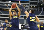 Michigan guard Trey Burke heads up to the bucket against forward Jordan Morgan during a day of practices and press conference for teams in the South Regional at Cowboys Stadium in Arlington, Texas on Thursday, March 28, 2013.