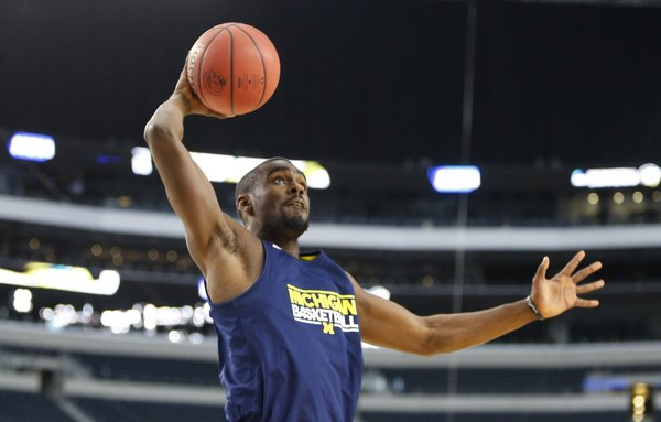 Michigan guard Tim Hardaway Jr. heads in for a dunk during a day of practices and press conference for teams in the South Regional at Cowboys Stadium in Arlington, Texas on Thursday, March 28, 2013.