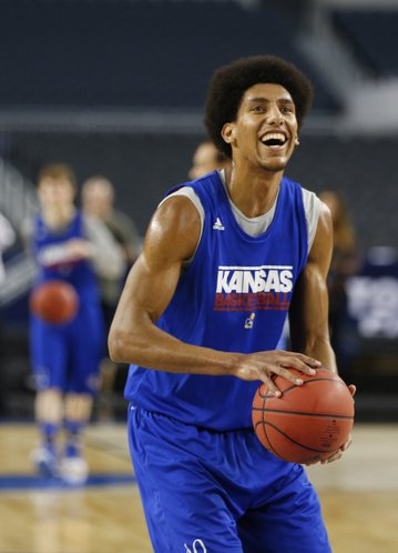 Kansas forward Kevin Young smiles as he and his teammates shoot around during a day of practices and press conference for teams in the South Regional at Cowboys Stadium in Arlington, Texas on Thursday, March 28, 2013.