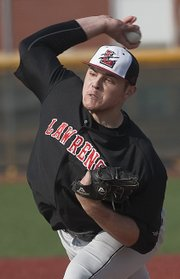 Lawrence High pitcher Bryce Montes de Oca delivers against Olathe Northwest on Thursday, March 28, 2013, at LHS.