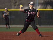 Lawrence High junior Marly Carmona throws to first during Lawrence High's softball game against Shawnee Mission Northwest, Thursday, March 28, 2013 at LHS.