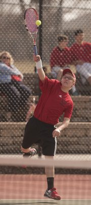 Lawrence High freshman Elliott Abromeit returns a shot during a doubles match on Thursday, March 28, 2013, at LHS.